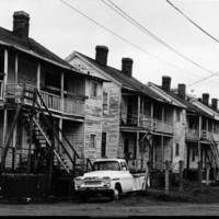 Cabbagetown_neighborhood_comprised_of_mill_houses_next_to_factory_1980.jpg