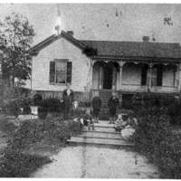 Harris family in front of home before it was renovated